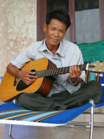 Playing Khmer songs on the guitar.